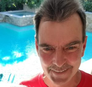 Man standing in front of pool